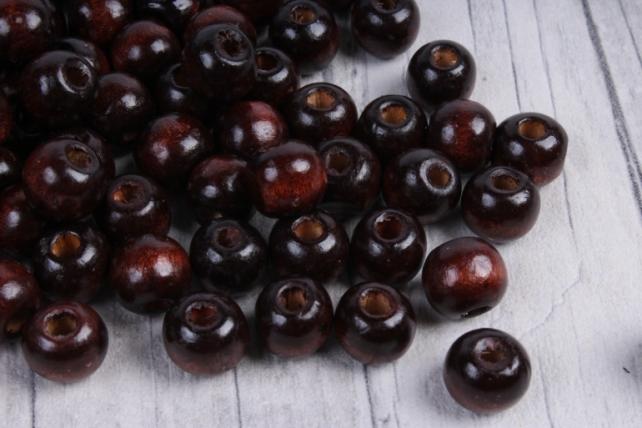 Бусины дерево  (С)  круглые  коричневые(10мм) в пакете 100гр