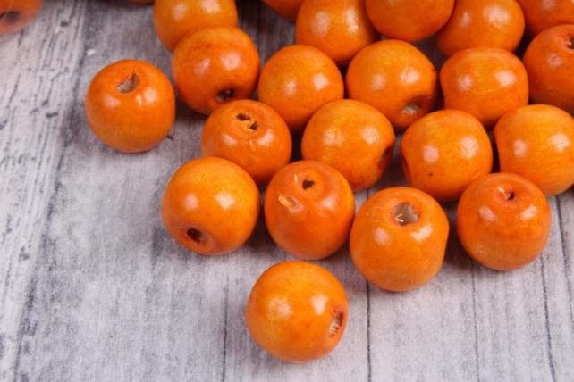 Бусины дерево  (С)  круглые  оранжевые (15мм) в пакете 100гр