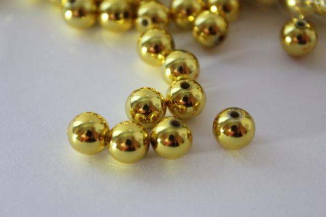 Бусины перламутров. цветные  (8мм) в пакете 100гр Золотые