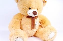 Игрушка мягкая Медведь рыжий с заплаткой коричневый бант  М-2124/60
