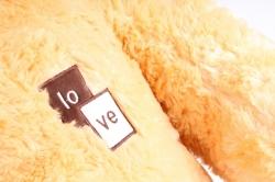 Игрушка мягкая Медведь с бантом рыжий   М-1118/80