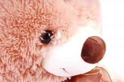 Игрушка мягкая Медведь светло-коричневый с заплаткой коричневый бант М-2124/60