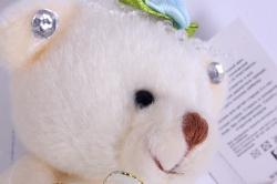 Медведь для букета (голубое платье) h=12см  Х1417/7